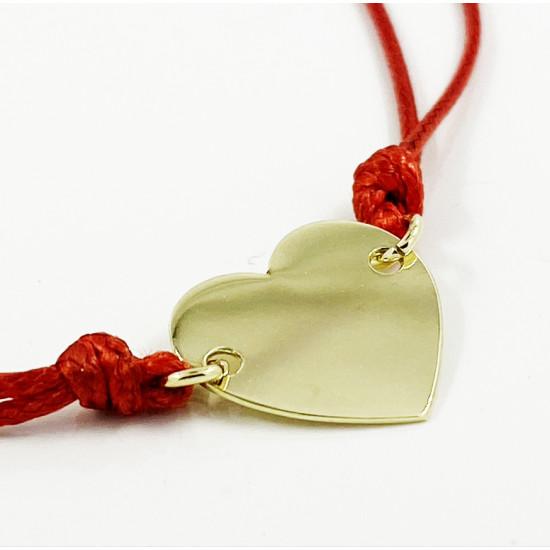 Zlaté srdce na červenej šnúrke